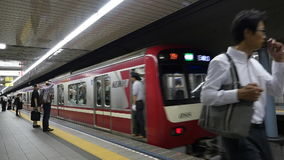 Train Exiting Subway Station at Busy Tokyo Metrorail System - Tokyo Japan stock footage