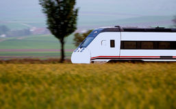 Train. On field spikes and landscape Royalty Free Stock Photos