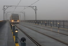 The train in fog. Porto, Portugal Royalty Free Stock Photography