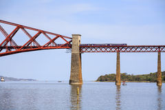 Train on the Forth Bridge in Scotland Royalty Free Stock Photography