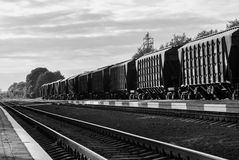Train with freight cars. Old cargo containers connected together to form train Royalty Free Stock Photos