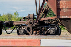 Train with freight cars. Old cargo containers connected together to form train Stock Photos