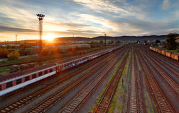Train freight station - Cargo transportation. At sunset Stock Photography
