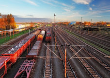 Train freight station - Cargo transportation. At sunset Stock Photo