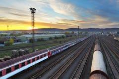 Train freight station. Cargo transportation at sunset Stock Photo