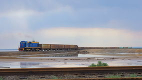 Train with freight wagons trailed carries cargo. The locomotive carries salt salty lake Baskunchak. stock video footage
