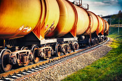 Train with fuel petrol tanks on the railway. Set of tanks with oil and fuel transport by rail Stock Image