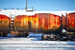 Train with fuel petrol tanks on the railway. Set of old tanks with oil and fuel transport by rail in winter Royalty Free Stock Image