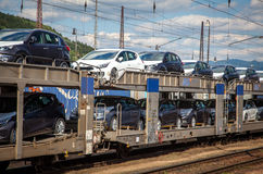 Train full of new cars Stock Photography
