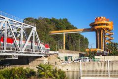 Train goes on bridge towards Sochi Stock Photography
