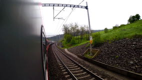 A train goes down its way passing by the beautiful countryside landscapes stock footage