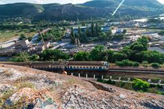 The train goes at the foot of the mountain. To the Crimea royalty free stock photos