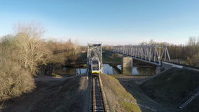 Train goes over the bridge. Passenger train goes over the bridge, filming from the top stock video