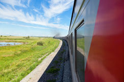 Train goes by rail in summer day Stock Photography