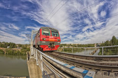 Train goes on railway bridge through Volga-don canal. Royalty Free Stock Photography