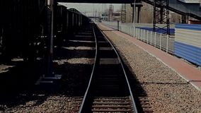 The train goes on railway tracks. Empty railroad track, outdoor landscape. Perspective view stock footage
