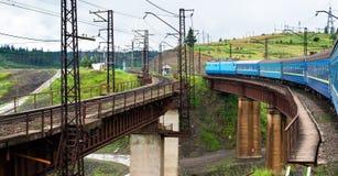 Train going across the bridge in the Carpathians Royalty Free Stock Photos