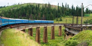 Train going across the bridge in the Carpathians Royalty Free Stock Images