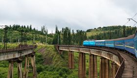 Train going across the bridge in the Carpathians Stock Images