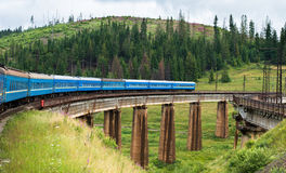 Train going across the bridge in the Carpathians Royalty Free Stock Photography