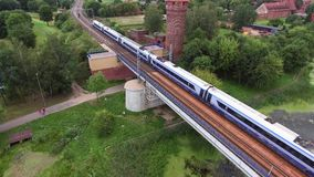Train going on bridge. Over river stock video footage