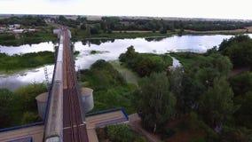 Train going on bridge. Over river stock video