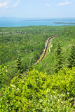Train going through northern Ontario Canada. Freight train moving through forest of northern Ontario near Lake Superior in Canada Stock Image