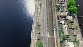 The train is going. The railway on the dam. Aero, aerial video, from the height, the marvelous landscape of the river and the dam stock video