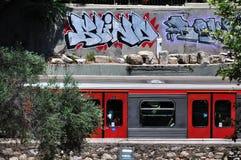 Train and graffiti. Subway car on a background wall with graffiti Stock Photo