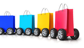 Train from group of paper shopping bags with car wheels Royalty Free Stock Photos