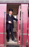 Train guard character. In 40's costume by a steam engine at the East Lancs Railway 40's weekend. Lancashire, UK royalty free stock photos