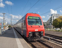 A train heading to Zurich arriving to the railway station Stock Photos
