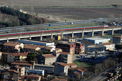 Train and highway in Italy Royalty Free Stock Image