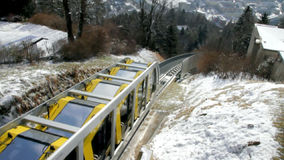 Train of Hungerburgbahn. Innsbruck, Austria. The state-of-the-art funicular railway connecting Innsbruck with its hilly suburb of Hungerburg was opened in 2007 stock video footage
