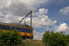 Train hurtles past in the natural environment. Of the Netherlands Royalty Free Stock Image