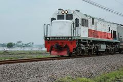 Train in Indonesia, drove quickly, version 1. Train in Indonesia, drove quickly, in the afternoon, on the rails, version 1 royalty free stock photography