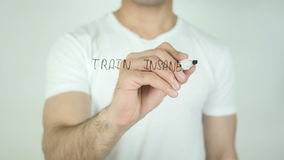 Train Insane or Remain the Same, Writing On Transparent Screen. Man writing stock video footage