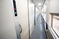 Train interior - empty passageway. The train interior with many rooms closed and empty passageway Stock Photography