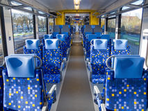 Train interior. Interior of an empty passenger train car with two rows of seats Royalty Free Stock Photography