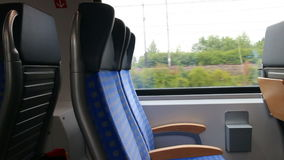 Train interior. Train travel concept - seats in interior of modern passenger car in motion stock video footage