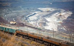 Train at the iron ore opencast mine is going for loading iron Royalty Free Stock Images