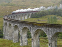 Steam train on Glenfinnan viaduct. Royalty Free Stock Images