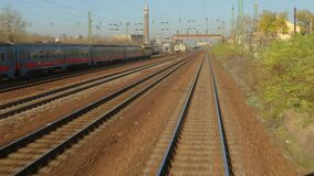 Railway travel view. Train journey point of view through an industrial area stock video footage