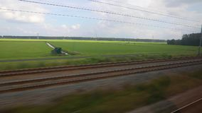 Train journey window view. Train journey in slow motion agricultural fields stock footage
