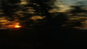 Train journey sunset light. Train window view with dramatic sunset light stock video