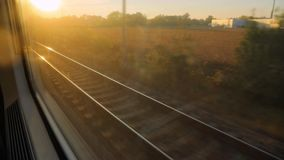 Train journey sunset light. Train window view with sunlight at sunset stock video