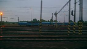 Train journey window view. Train leaving an industrial area stock video