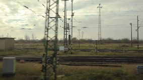 Train journey window view. Train leaving an industrial area, 60fps video stock footage