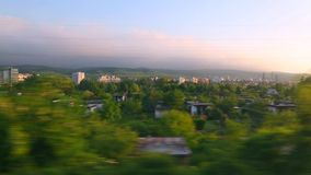 Train journey window view. Train leaving the town slowly stock footage