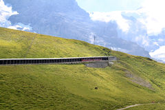 Train of the Jungfraubahn in Swiss mountain tunnel royalty free stock photos